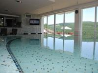 Wellness pool with panoramic view to Kekesteto in Hotel Ozon Residence